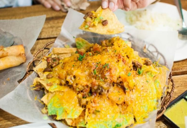 Campfire nachos on a picnic table