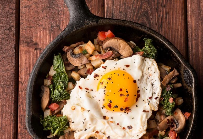 A camping skillet meal in a cast iron skillet