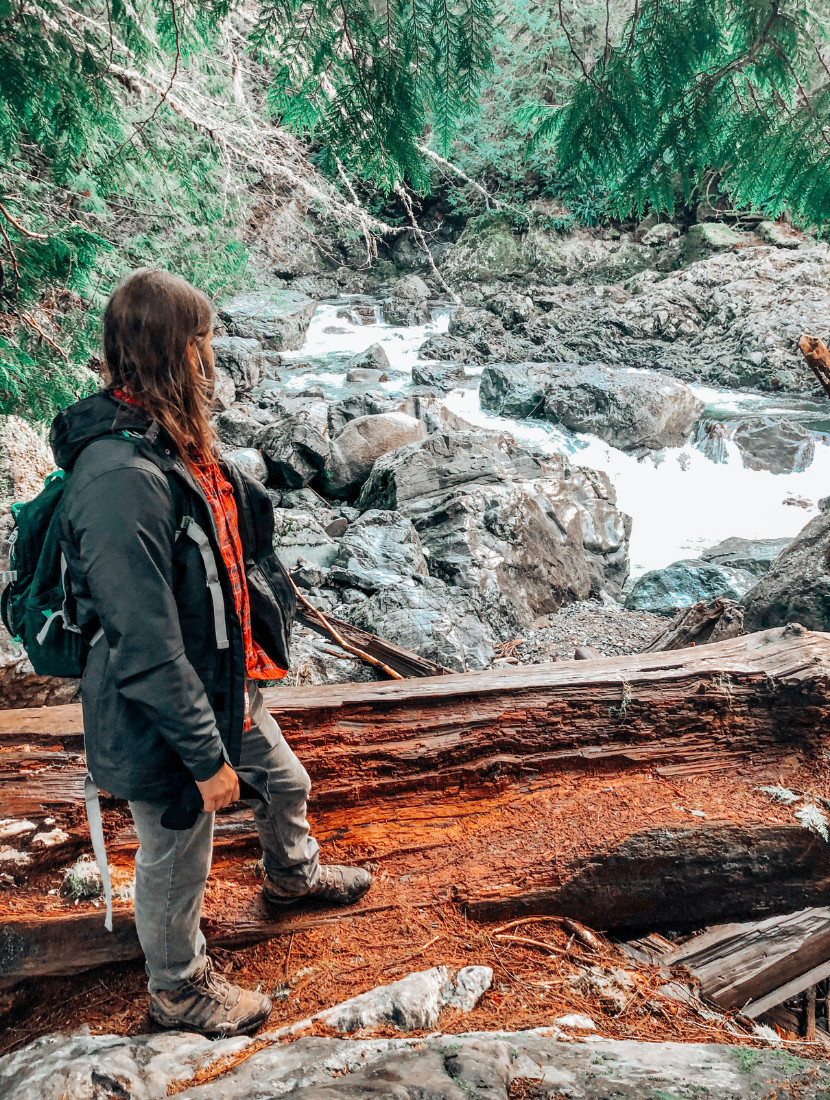 Dalton standing in front of the Snoqualmie River along the Twin Falls Trail