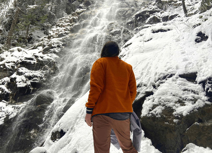 Cait wearing her winter hiking pants in front of Teneriffe Falls in Washington