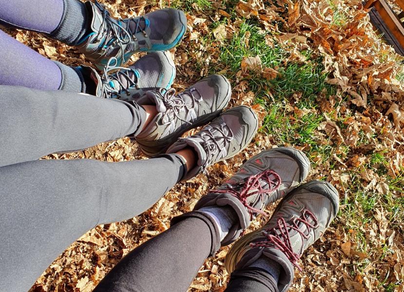 Three women wearing hiking leggings and hiking boots