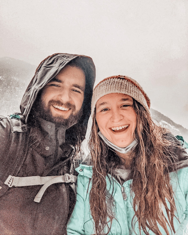 Cait and Dalton smiling in front of Lena Lake in Washington state