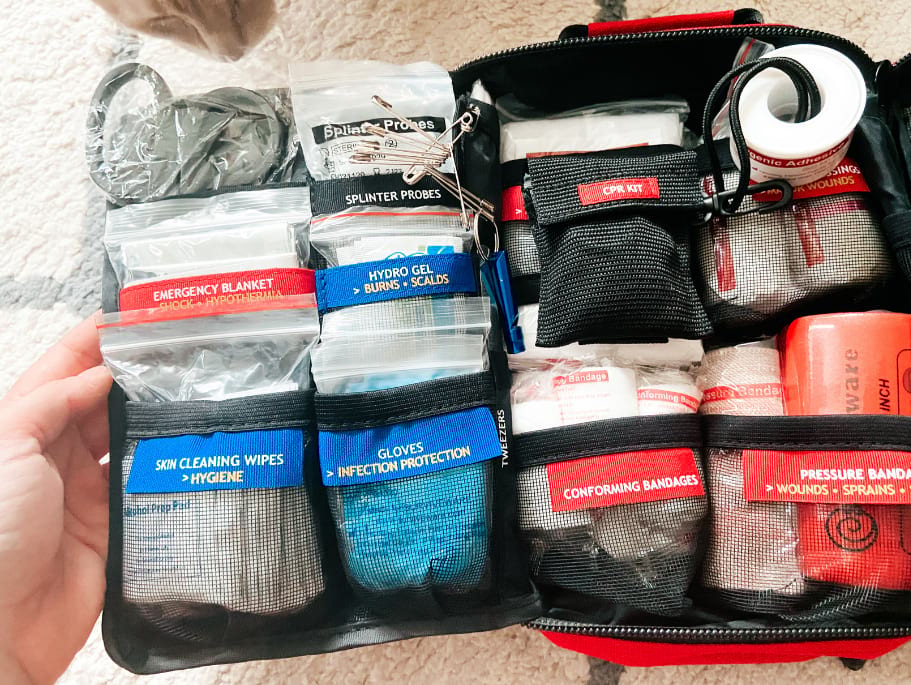 The inside of a Surviveware kit - includes dozens of labeled pockets to keep all of your kit contents organized
