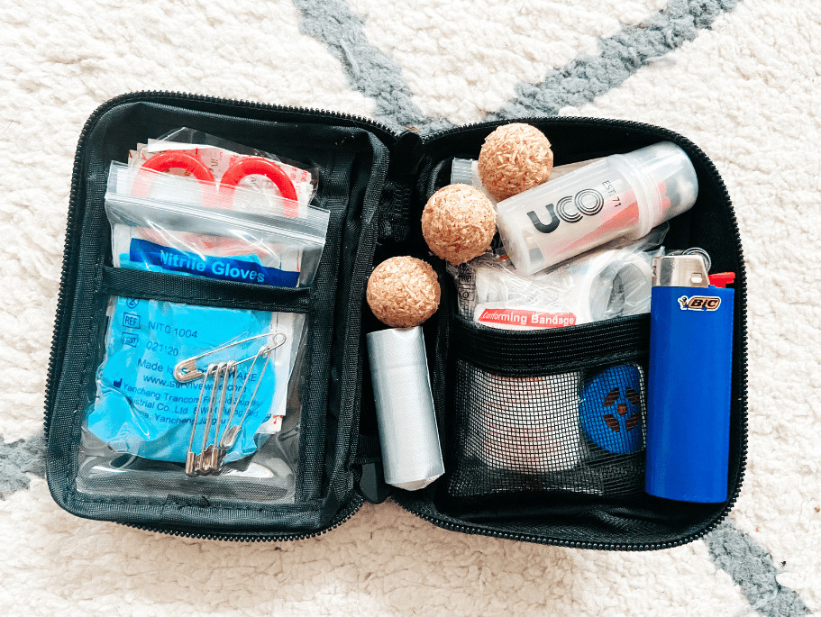 The mini kit opened up with added fire starters, a lighter, a roll of duct tape, and waterproof matches
